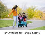 Mother Pulling Children In Wagon