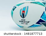 Small photo of July 14, 2019 : Malaysia - Malacca. Close up of a Mini Official Replica Rugby Ball by Gilbert for the Rugby World Cup Japan 2019. Isolated on white background, promo product shot.