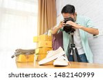 asian man taking photo to shoes ... | Shutterstock . vector #1482140999
