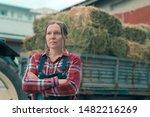 Female Farmer Posing In Front...