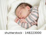 small sleeping baby in bed  up... | Shutterstock . vector #148223000