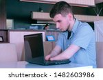 Small photo of Computer online job. Disabled man freelancer with amputated two stump hands in cafe typing works on laptop Problem of adaptation to life people disabilities. Independent handicapped invalid young guy.