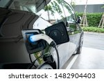 Small photo of EV Car. Electric car. Charging Station with the power cable plugged in.Technology car. A Future transport. Recharging. High technology . Transportation EV. Transport EV car. Innovation future.