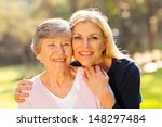 Smiling Senior Woman And Middl...