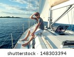 happy young man on a yacht | Shutterstock . vector #148303394