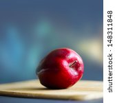 red apple on the wooden board   Shutterstock . vector #148311848