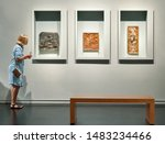 Stock photo woman visitor looking pictures in art gallery museum 1483234466