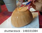 Art class for senior citizens, painting ceramics - stock photo