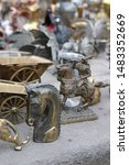 Small photo of Georgia, Tbilisi - March 2019: unusual flea market with big assortment of antiques, copper figures, bronze animals and bric-a-brac on sale. Old Market (Dry Bridge), ancient market in Tbilisi, Georgia
