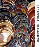 painted wooden bowls in rows in ... | Shutterstock . vector #148336784