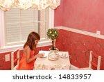 a cute young girl having tea in ... | Shutterstock . vector #14833957