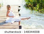 pregnant woman resting on the... | Shutterstock . vector #148344008