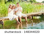 Happy Young Family Fishing On...