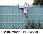 Girl Climbing Metal Fence...