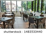 Stock photo modern hotel restaurant furniture interior with windows at sunny day 1483533440