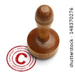 Red Copyright Stamp with Wooden Stamper Isolated on White Background.