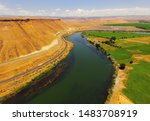 Aerial View of Snake river bends around bluffs and farmland in Glenn
