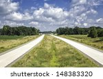 Empty highway at sunny day against blue sky - stock photo