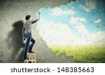 young man drawing a cloudy blue ... | Shutterstock . vector #148385663