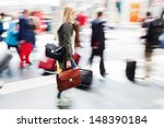 traveling people at the railway station in motion blur - stock photo