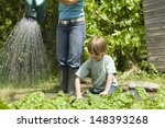 young boy gardening with mother ...   Shutterstock . vector #148393268
