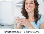 radiant brunette drinking... | Shutterstock . vector #148419698
