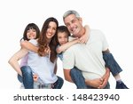 smiling parents holding their... | Shutterstock . vector #148423940
