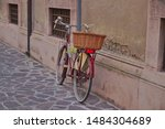 City Bike With A Basket Stands...