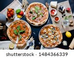 top view group shot pizza or... | Shutterstock . vector #1484366339