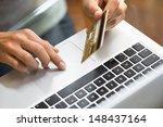 woman shopping using laptop at... | Shutterstock . vector #148437164