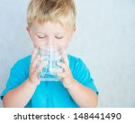 portrait of boy drinking glass... | Shutterstock . vector #148441490
