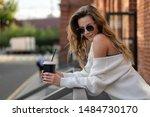 european girl in white sweater... | Shutterstock . vector #1484730170