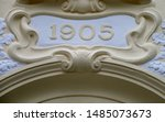 The year 1905 above the entrance to a public building