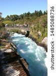 Small photo of New Zealand near Lake Taupo. The Waikato River that drains from the lake. Width from 100 to 15 meters across. View of river in spate with white foaming water confined between a narrow tree lined gorge