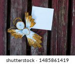 Paper Angel On The Wooden...