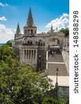 Small photo of BUDAPEST, HUNGARY - JULY 24: Image with Fishermen Bastion taken on July 24, 2013, in Budapest, Hungary. Conical towers from Castle Hill, are an allusion to the tribal tents of the early Magyars.