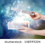opening a gift box with magical ... | Shutterstock . vector #148595204