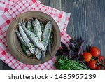 Stock photo baltic herring seafood salted herring fish in a bowl with spices and herbs wood background 1485957239