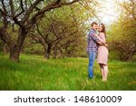 loving happy couple are hugging ... | Shutterstock . vector #148610009