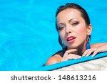 beautiful girl in swimming pool | Shutterstock . vector #148613216