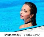 beautiful girl in swimming pool | Shutterstock . vector #148613240