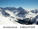 Winter landscape on Kasprowy Wierch mountain, beautiful view of other peaks in Tatra Mountains, near Zakopane in Poland