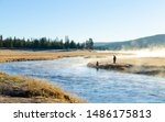two men fishing at Yellowstone national park at the morning in the river with fog