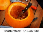 hollowing out a pumpkin to... | Shutterstock . vector #148639730