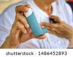 Elderly Female's Hand Use...