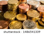 Several Euro Coins Stacked Per...