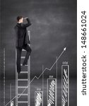 businessman climbing on ladder... | Shutterstock . vector #148661024