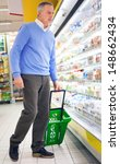 Man shopping at the supermarket - stock photo