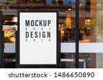 Small photo of Mockup advertising board in front of supermarket. Mock up billboard for your text messege or mock up content with department store or shopping mall background.
