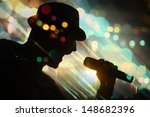 energetic singer. silhouette. | Shutterstock . vector #148682396